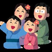 花火鑑賞する家族